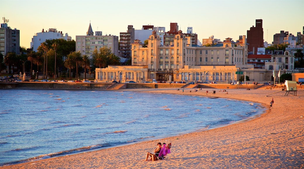 Uruguay showing a sunset, general coastal views and a city