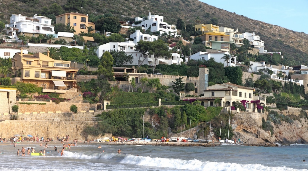 Moraira featuring a coastal town, swimming and waves