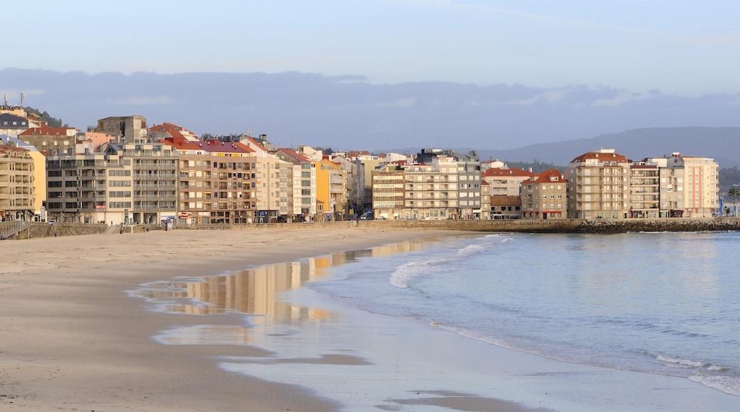 Sanxenxo featuring general coastal views, a coastal town and a sandy beach