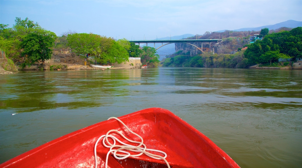 Canon del Sumidero National Park featuring a bridge, a river or creek and boating