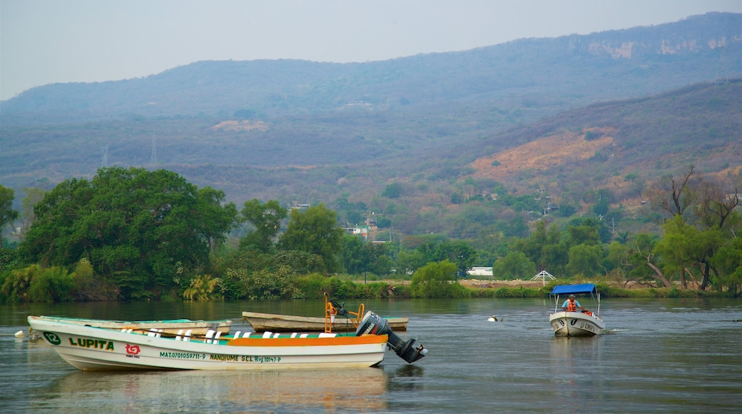Canon del Sumidero National Park which includes landscape views, boating and tranquil scenes