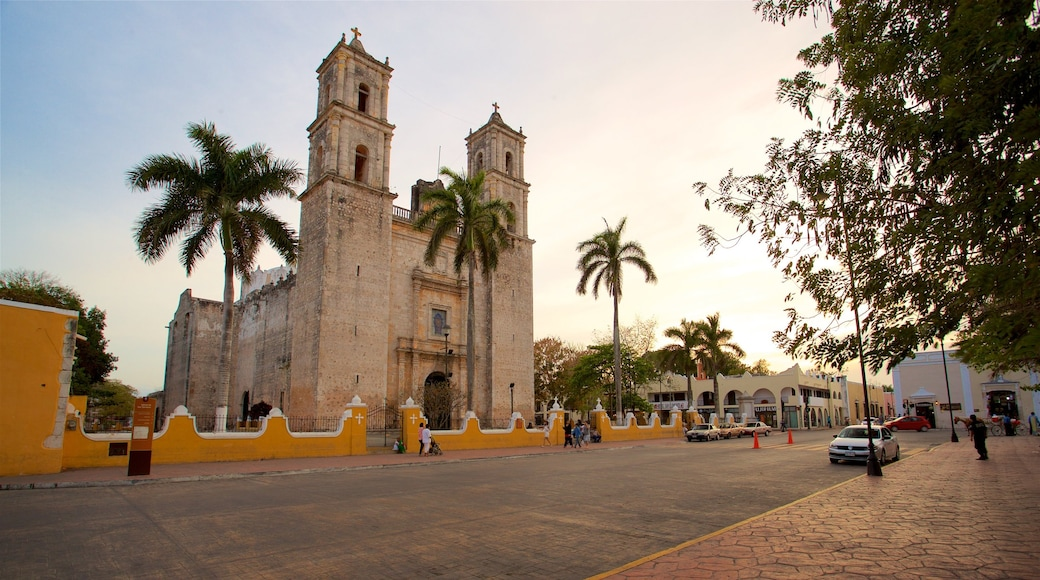 Cathedral of San Gervasio featuring heritage architecture and a sunset