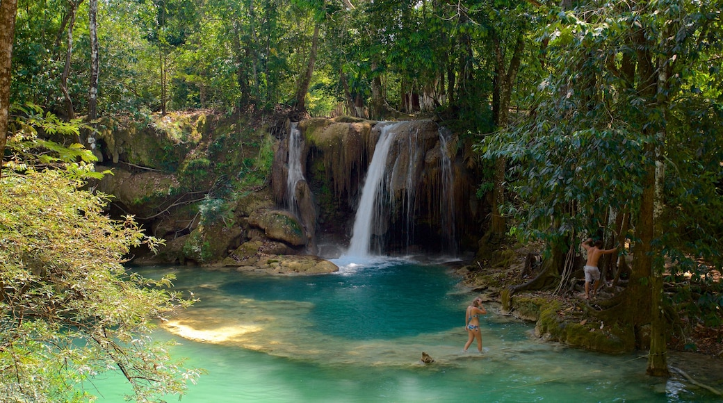 Cascada de Roberto Barrios which includes a river or creek and a waterfall as well as a couple