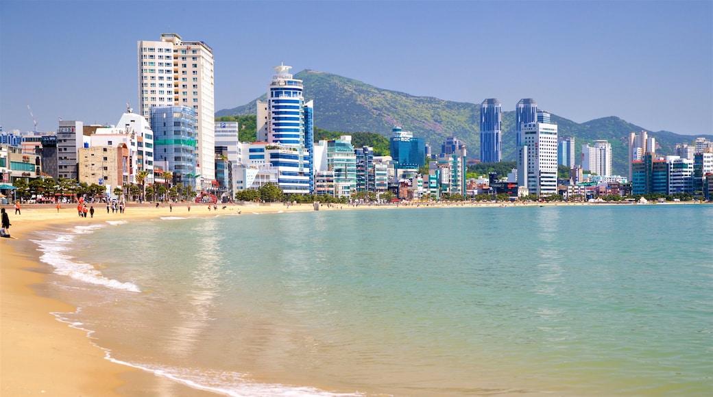 Gwangalli Beach showing a coastal town, a sandy beach and general coastal views