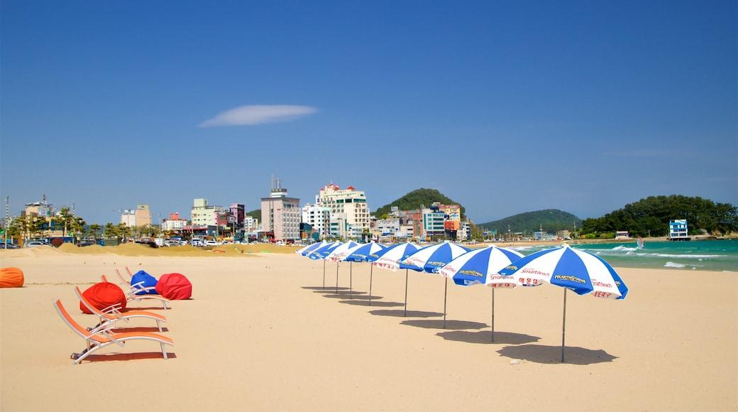 Songjeong Beach showing a beach, general coastal views and a coastal town