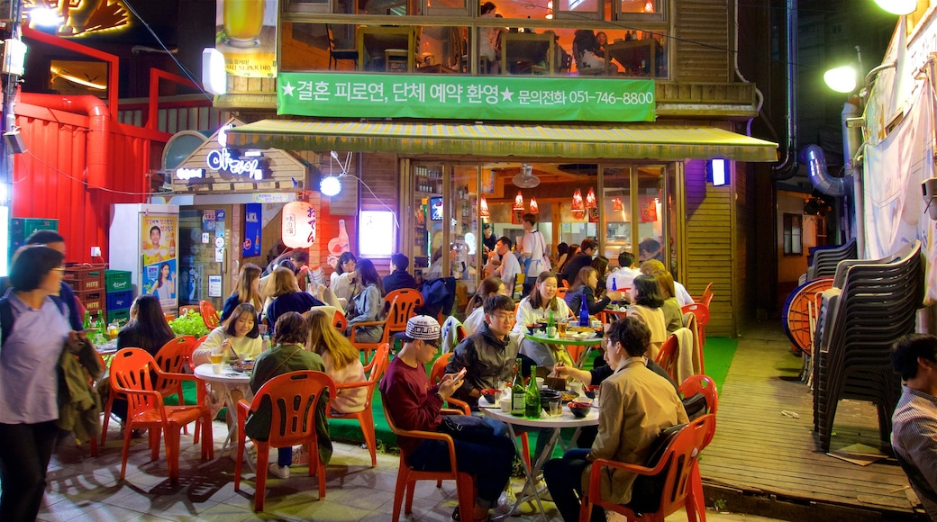 Busan which includes outdoor eating and night scenes as well as a small group of people
