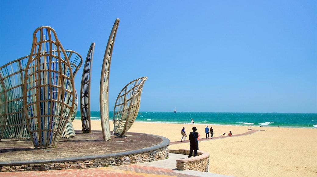 Haeundae Beach featuring outdoor art, general coastal views and a beach