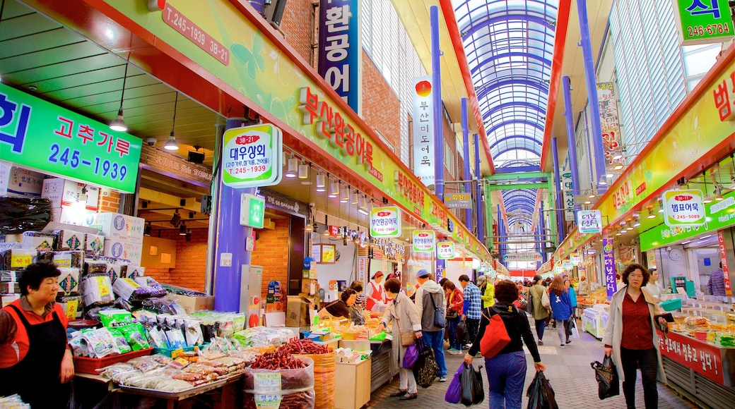 Gukje Market which includes interior views and markets as well as a small group of people