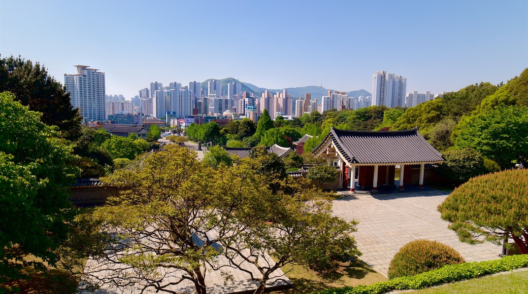Chungnyeolsa which includes a high-rise building, landscape views and a city