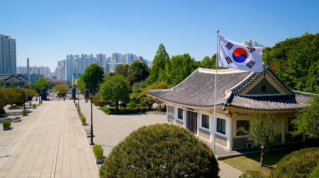 Chungnyeolsa which includes a city, landscape views and heritage elements
