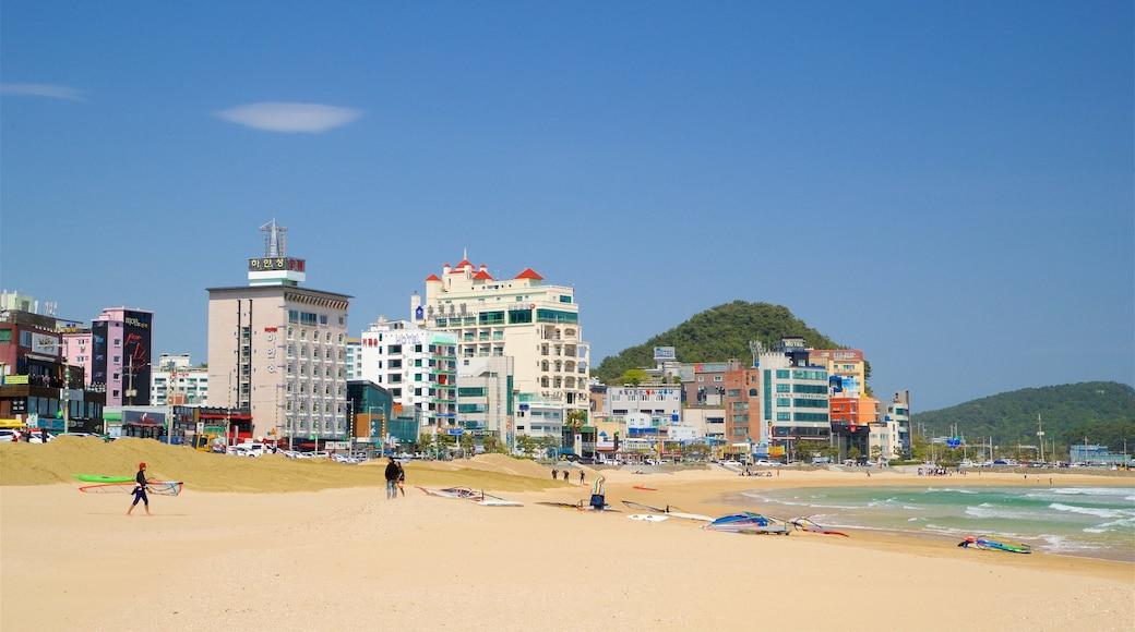 Songjeong Beach showing general coastal views, a sandy beach and a coastal town