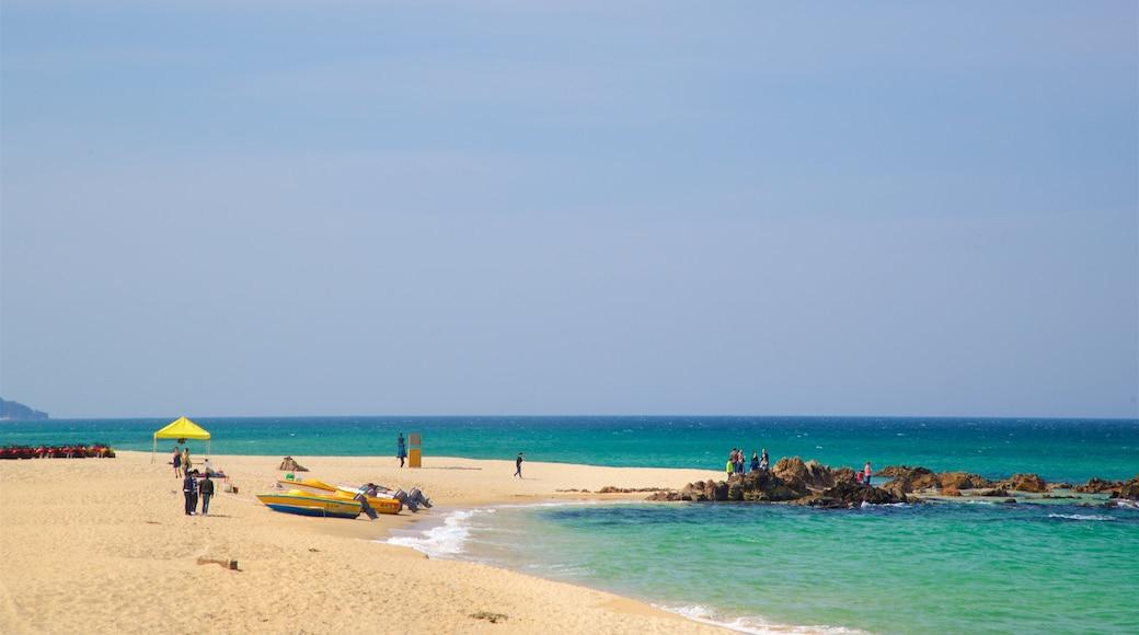 Jeongdongjin Beach showing general coastal views, a sandy beach and rugged coastline