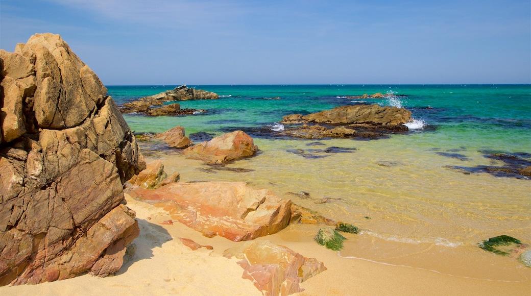Jeongdongjin Beach which includes a beach, rugged coastline and general coastal views