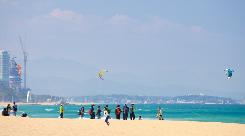 Anmok Beach which includes general coastal views and a sandy beach as well as a small group of people