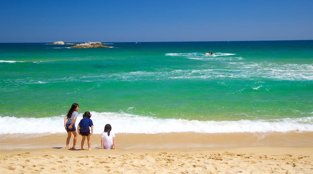 Gyeongpo Beach showing general coastal views and a beach as well as a small group of people