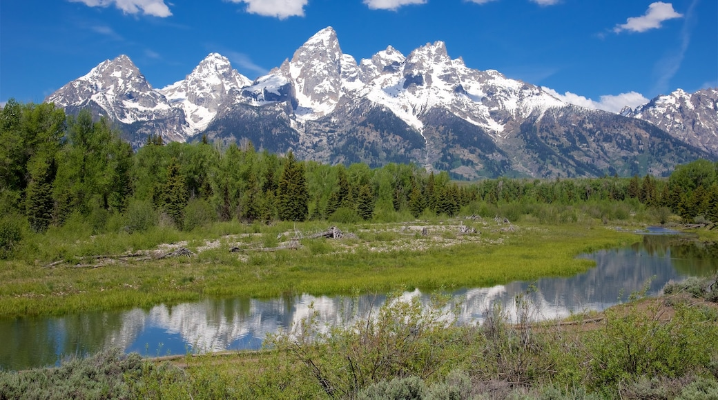 Schwabacher\'s Landing featuring snow, mountains and a river or creek