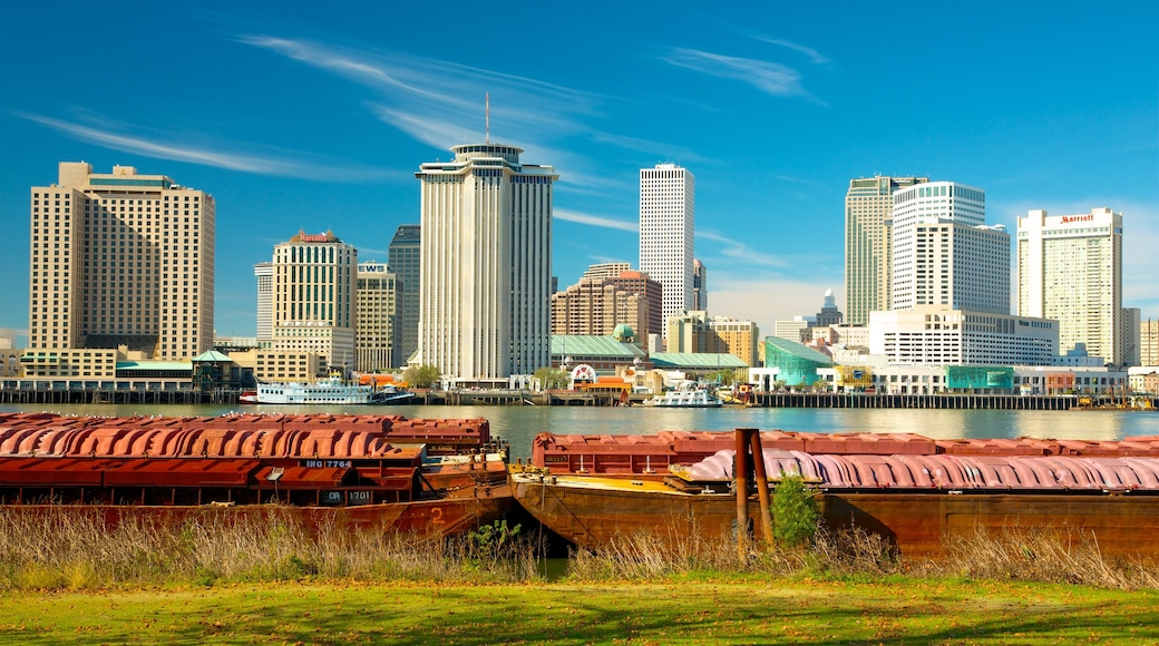 New Orleans showing a skyscraper, a city and a river or creek