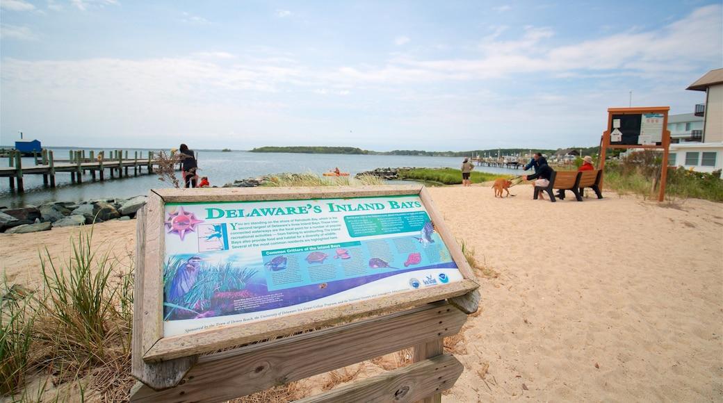 Dewey Beach which includes general coastal views, a beach and signage