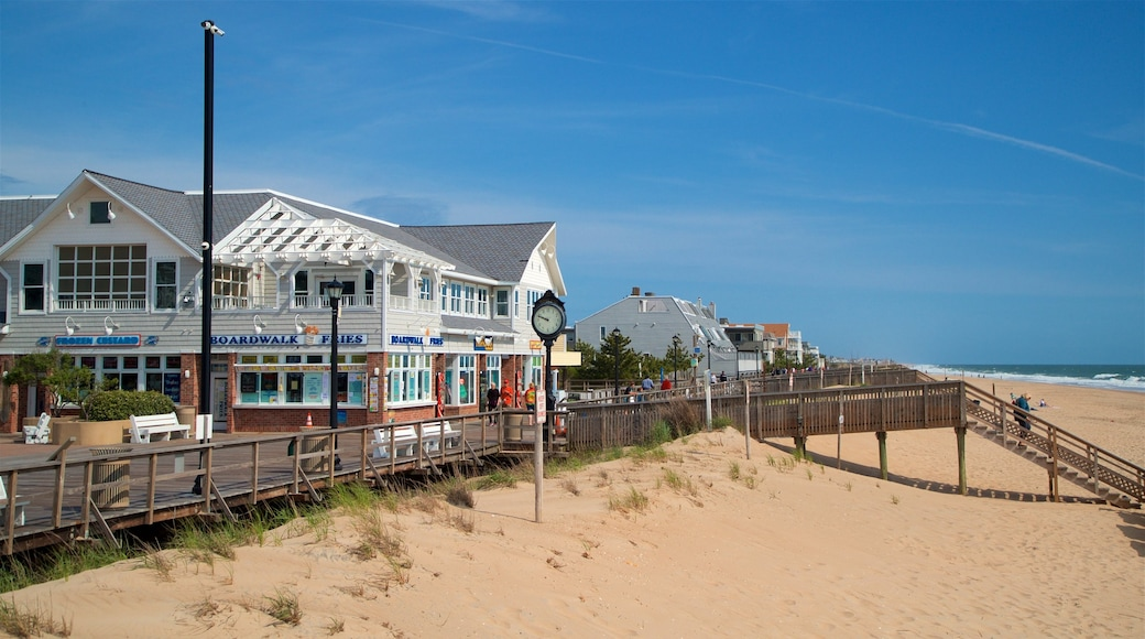 Bethany Beach which includes a sandy beach, a small town or village and general coastal views