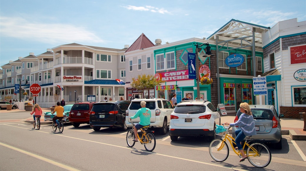 Bethany Beach showing road cycling and a small town or village as well as a small group of people