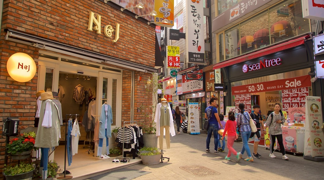 Myeongdong featuring shopping as well as a small group of people