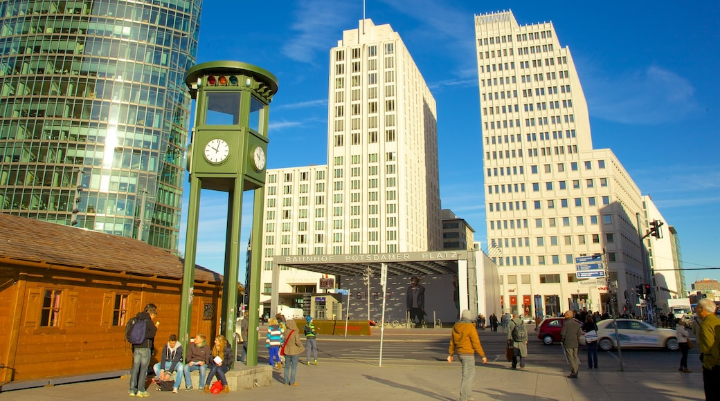 Potsdamer Platz which includes a square or plaza, a high-rise building and a city
