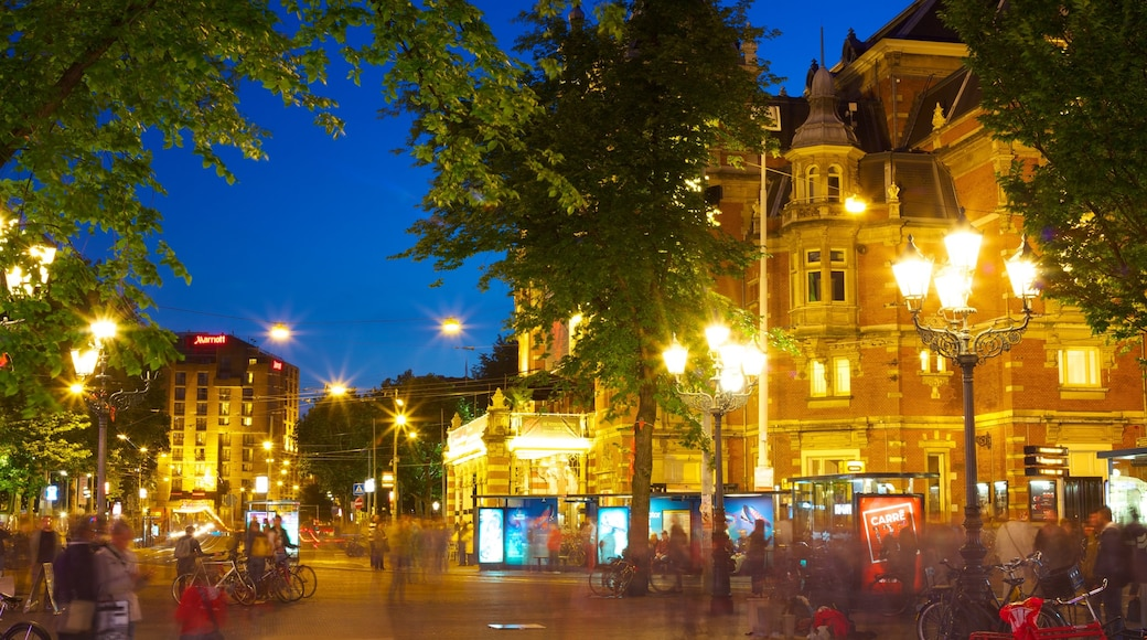 Amsterdam which includes heritage architecture, street scenes and night scenes