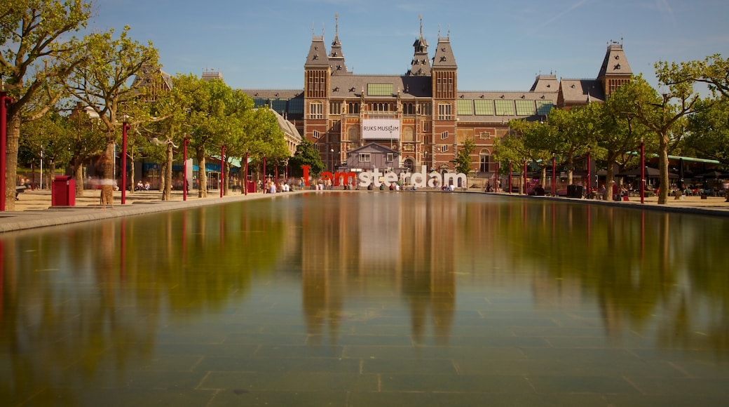 Amsterdam showing a square or plaza, heritage architecture and a castle