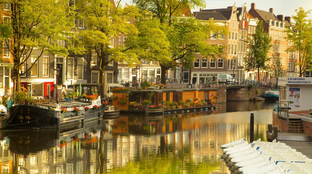 Amsterdam featuring a river or creek, boating and a city