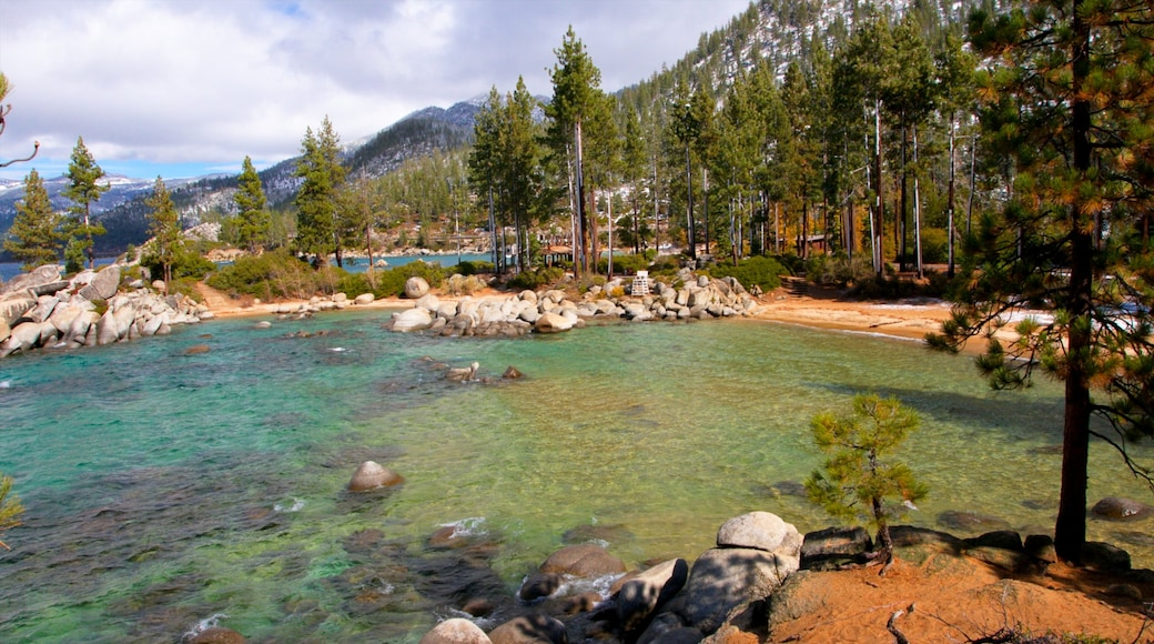 Sand Harbor which includes mountains, rocky coastline and forests