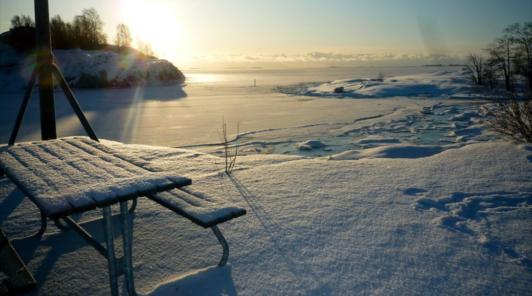 Helsinki featuring a sunset and snow