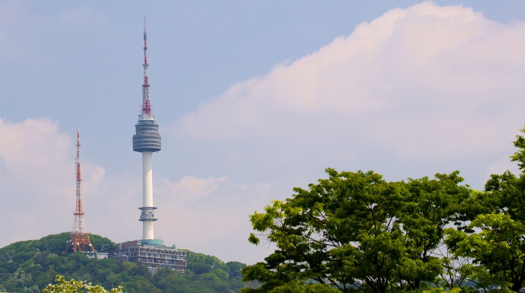 N Seoul Tower showing a high-rise building and a sunset