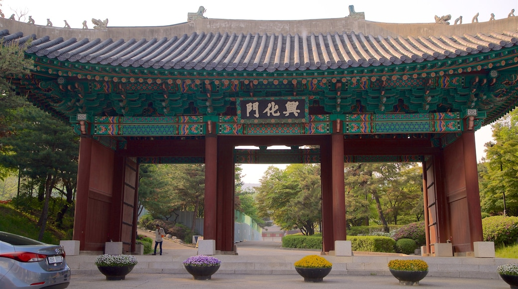 Gyeonghuigung Palace featuring a park, heritage elements and flowers