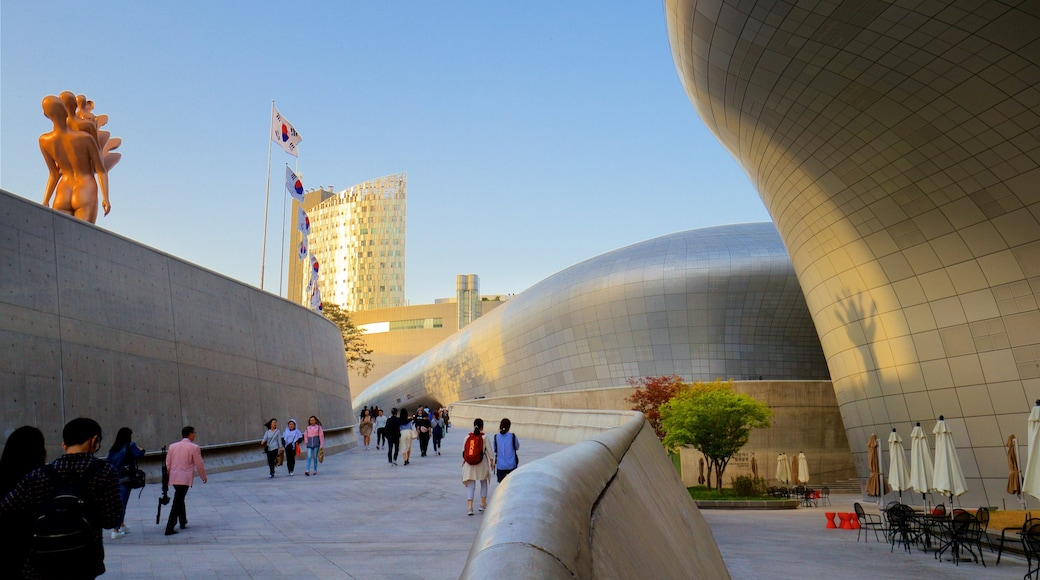 Dongdaemun Design Plaza featuring a sunset, outdoor art and modern architecture