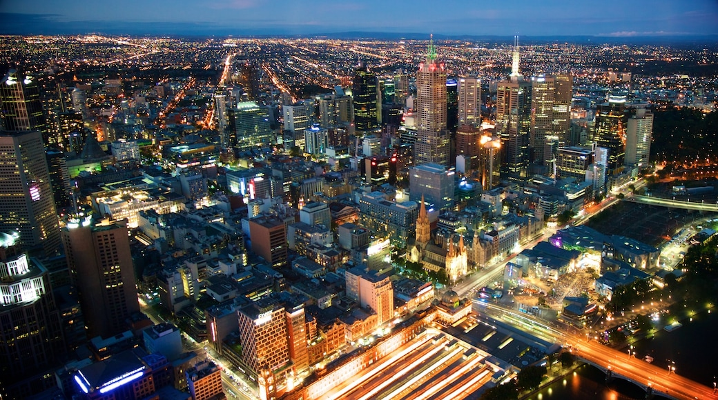 Melbourne which includes landscape views, a high rise building and night scenes