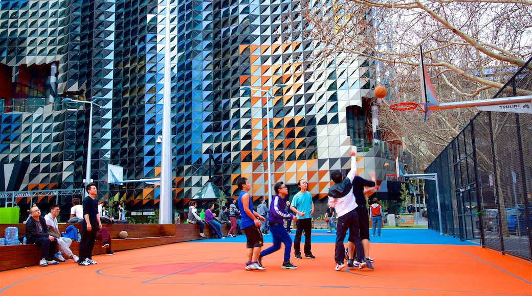 Australia showing a sporting event and a city as well as a small group of people