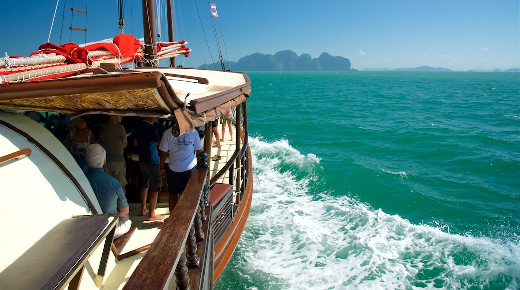 South Thailand which includes general coastal views and boating as well as a small group of people