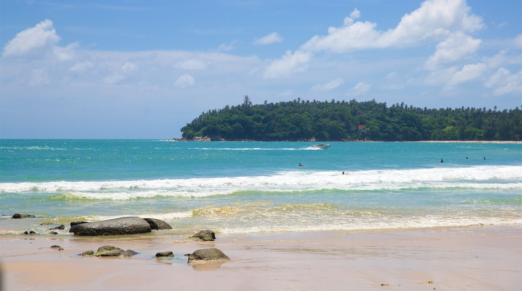 Kata Beach which includes a sandy beach, rugged coastline and swimming