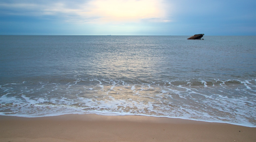 Sunset Beach which includes general coastal views and a beach