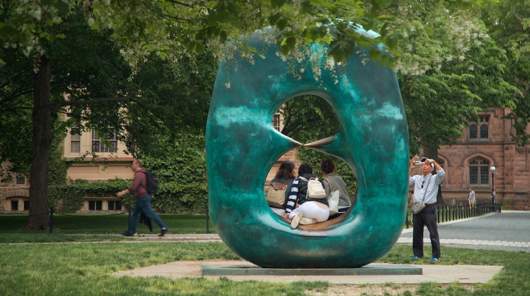 Princeton University showing outdoor art, street scenes and a garden