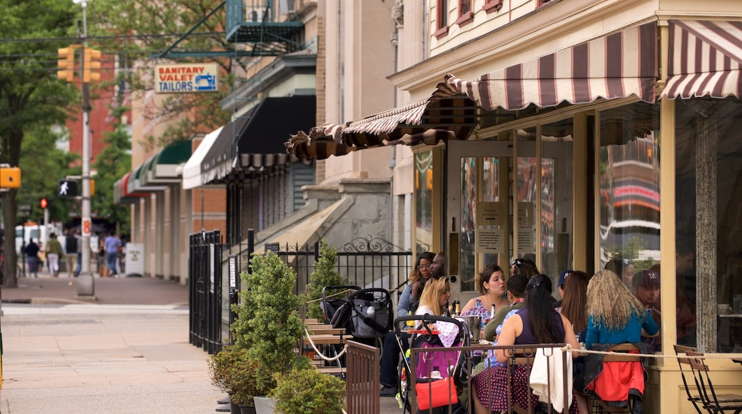 Downtown Jersey City showing outdoor eating as well as a small group of people