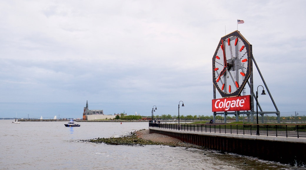 Colgate Clock which includes a bay or harbour and signage