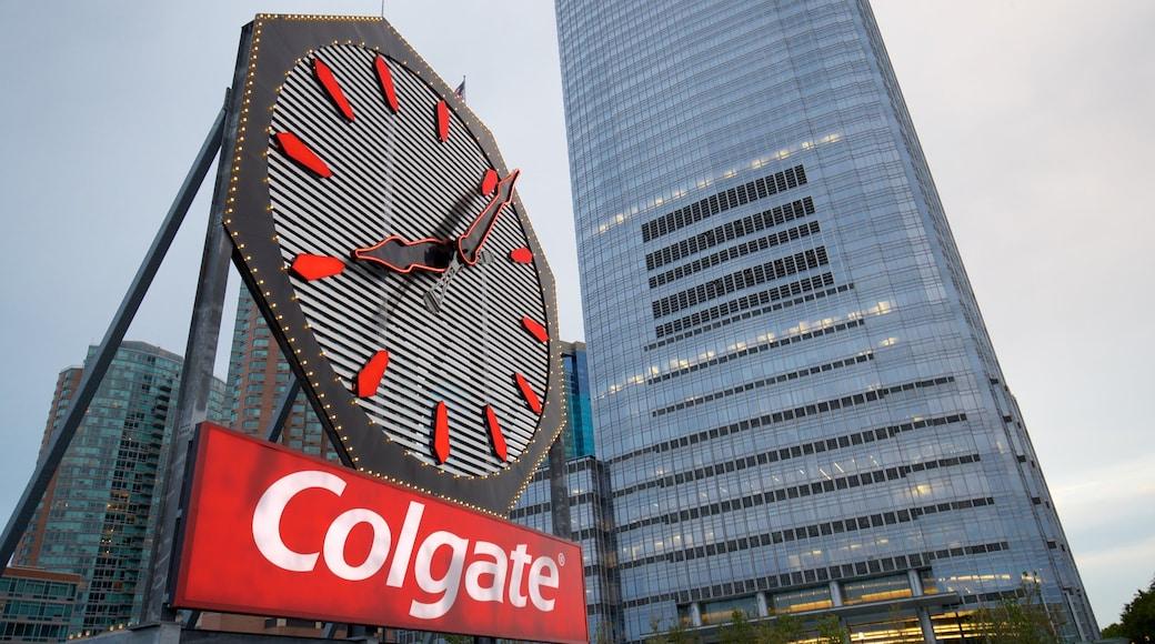 Colgate Clock featuring a skyscraper, a city and signage