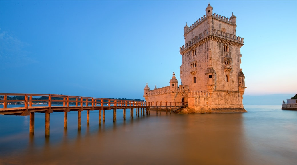 Belem Tower showing a lake or waterhole, a bridge and a sunset