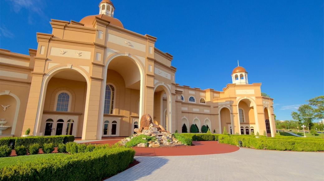 Sight and Sound Theatres showing outdoor art, heritage architecture and a garden