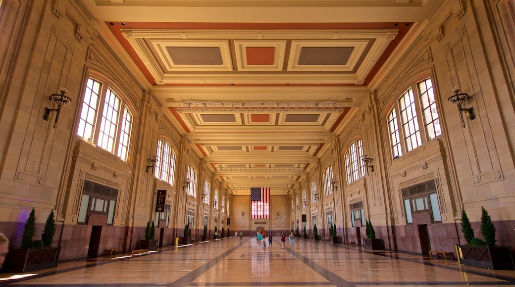 Union Station featuring heritage elements and interior views as well as a small group of people