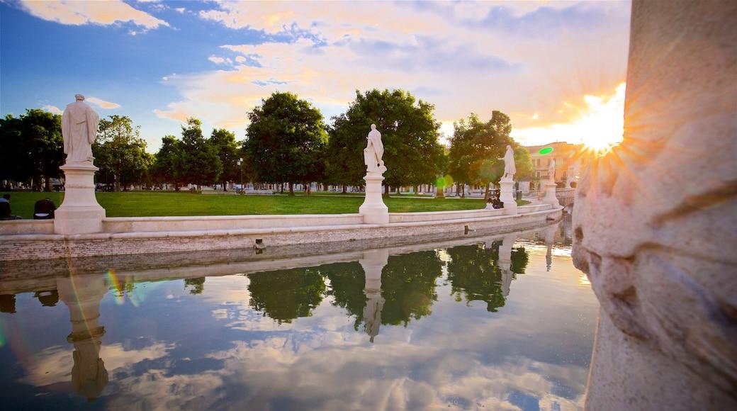 Prato della Valle which includes a garden, a sunset and a statue or sculpture