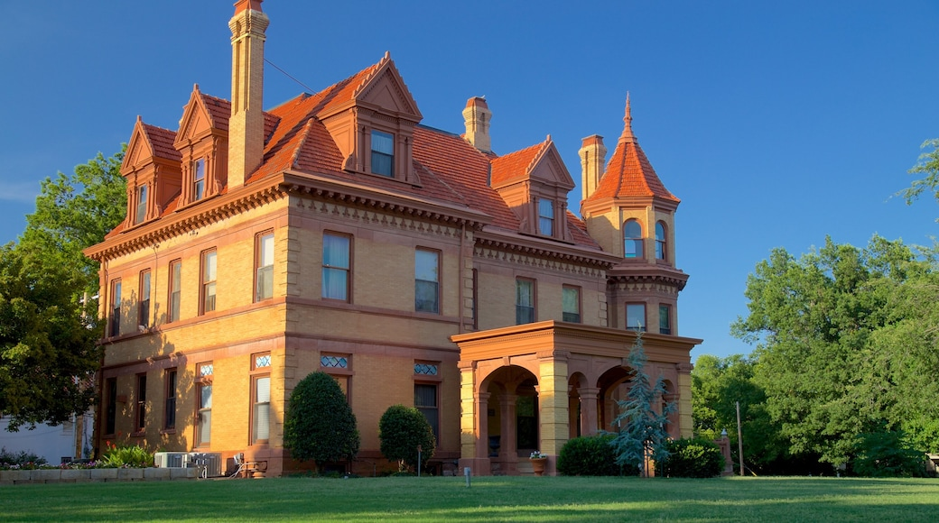 Overholser Mansion featuring heritage elements, a house and a garden