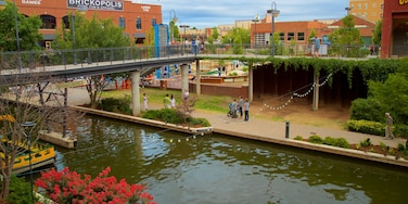 Bricktown showing a bridge, a river or creek and flowers