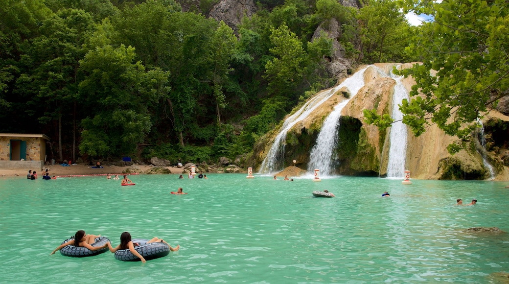 Turner Falls featuring swimming, a lake or waterhole and a waterfall